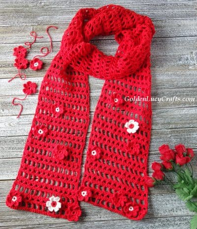 Crochet lacy red scarf.