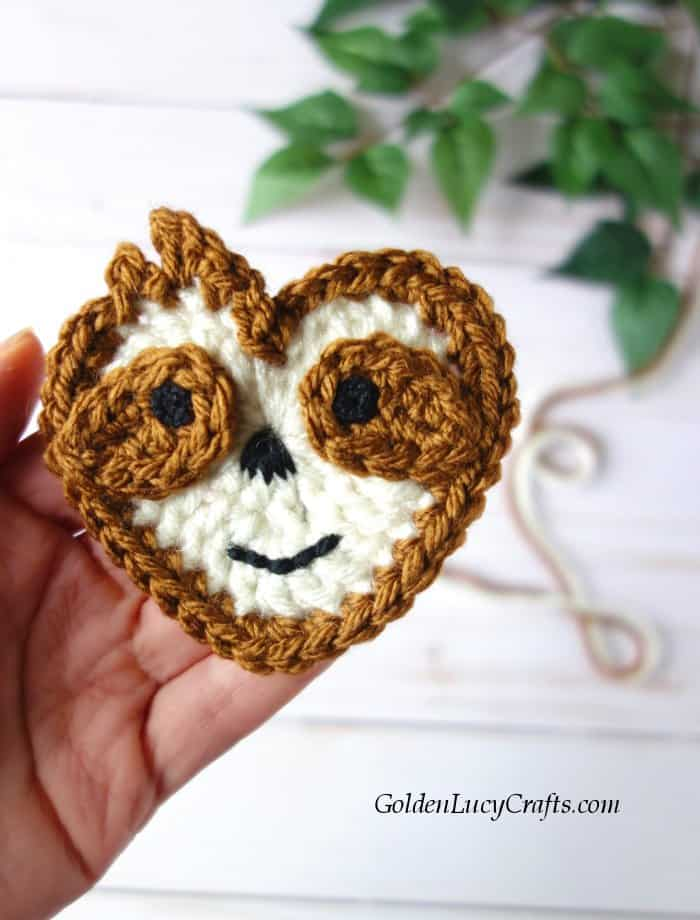 Cute crochet Sloth applique made in the shape of a heart