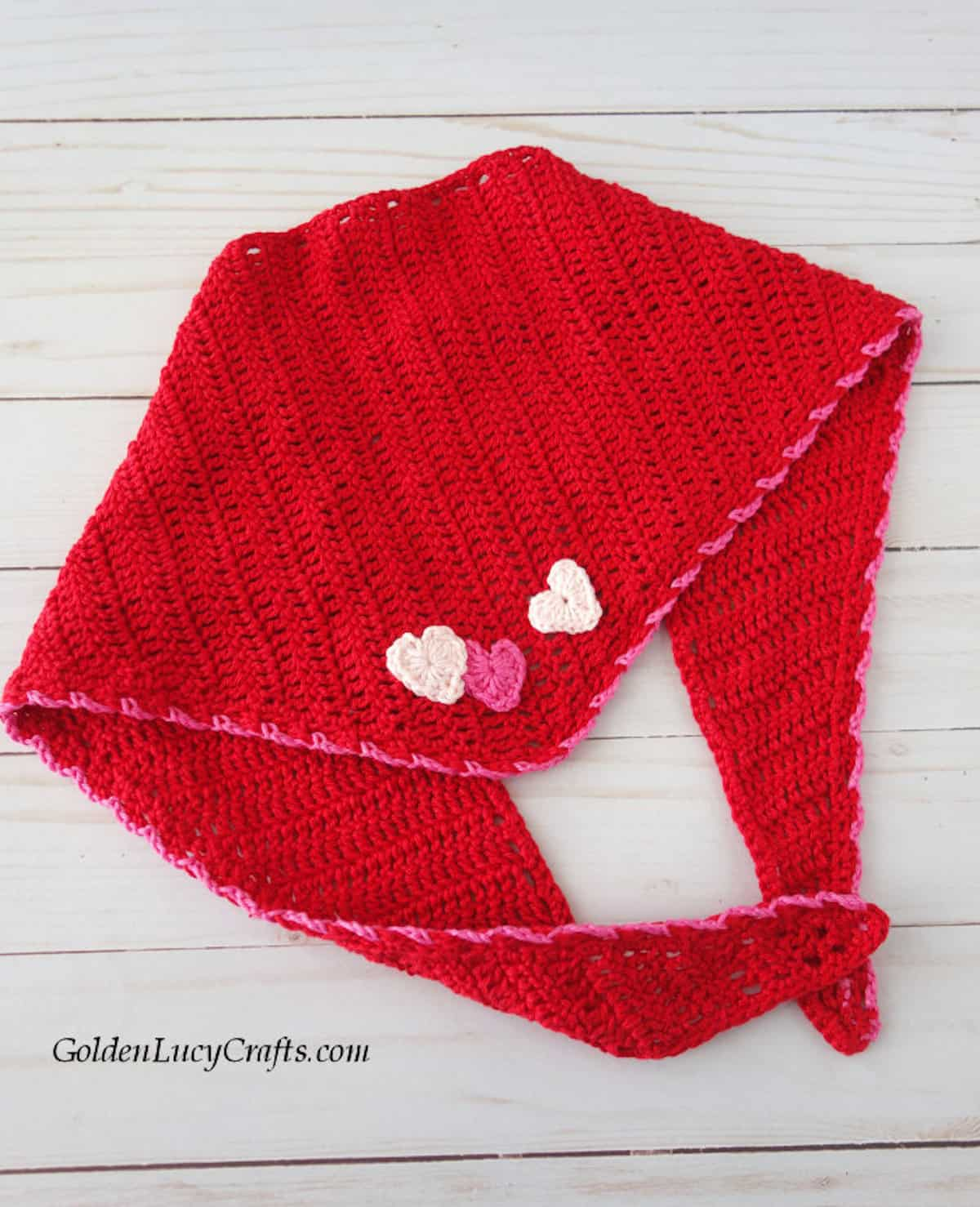 Red dog bandana for Valentine's Day embellished with three hearts.