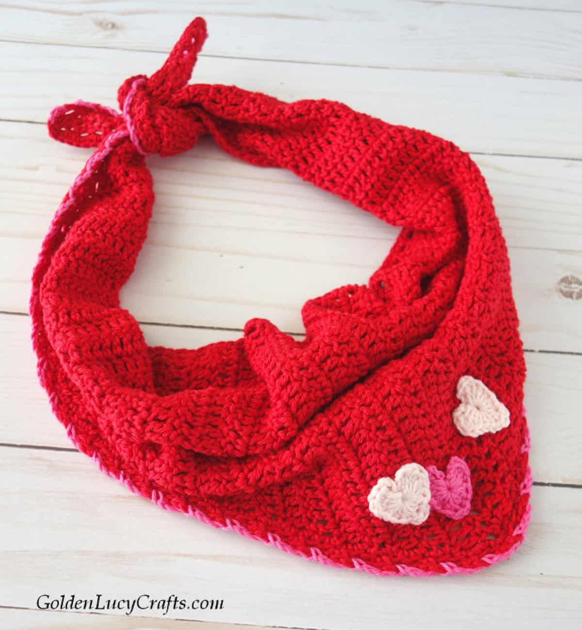 Red bandana embellished with three hearts.