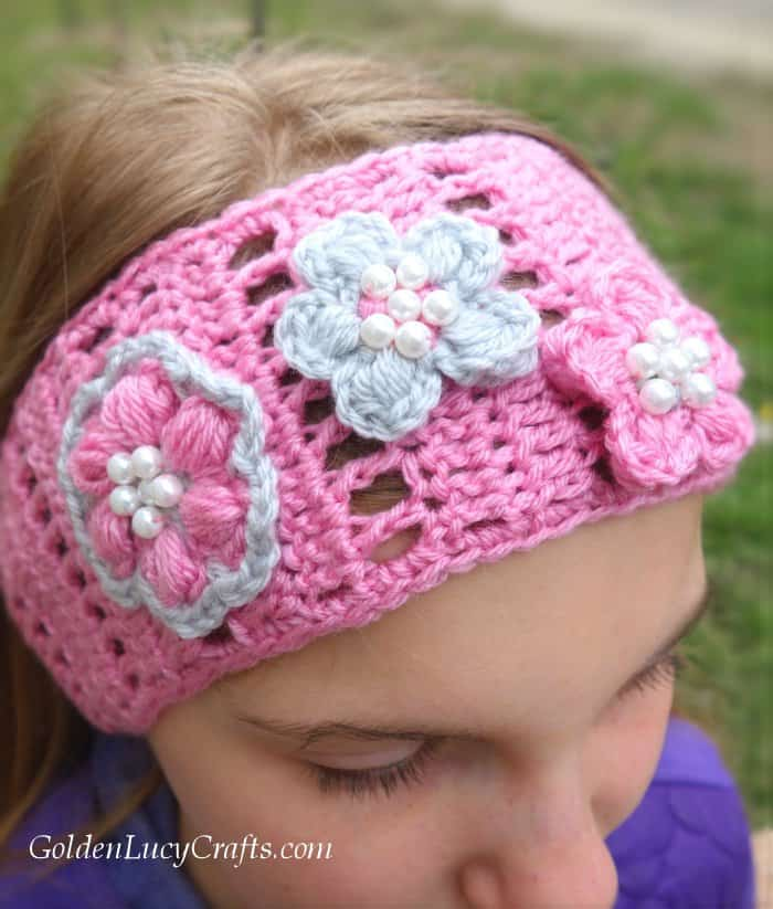 Young girl in pink crochet headband, close up picture.
