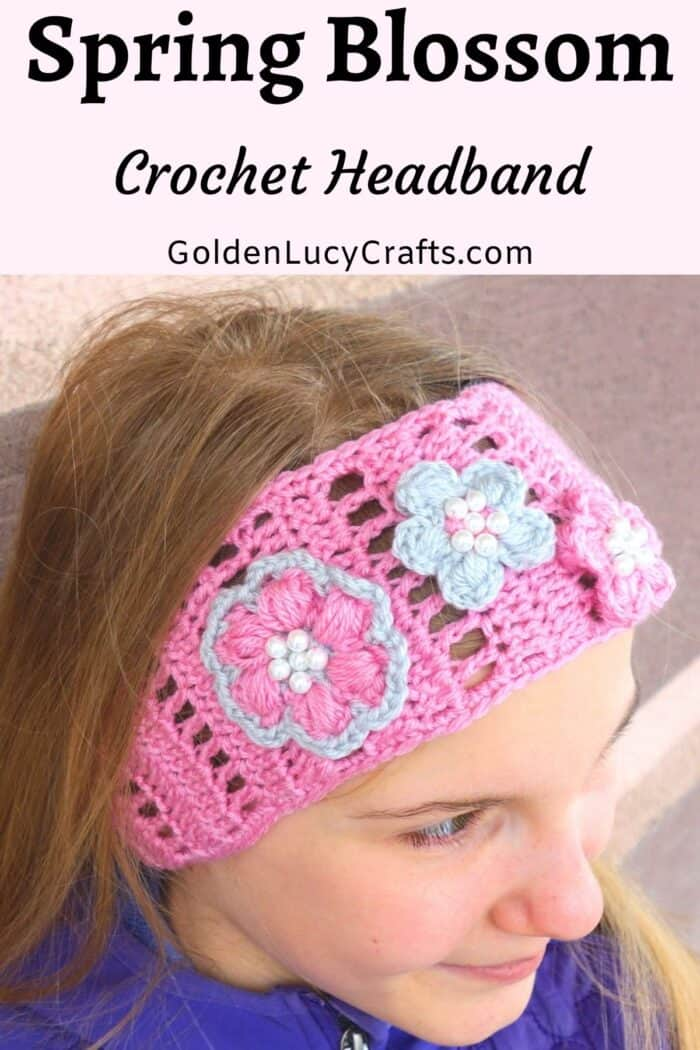 Young girl in pink crochet headband.