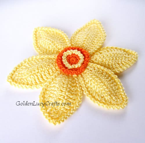 Crocheted yellow daffodil flower.