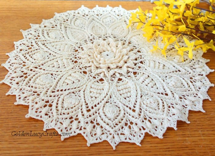 Crochet doily, yellow flowers