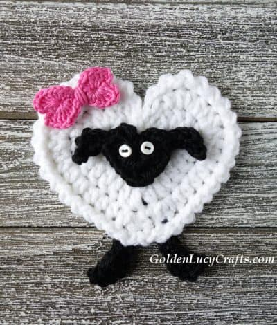 Crochet heart-shaped sheep applique.
