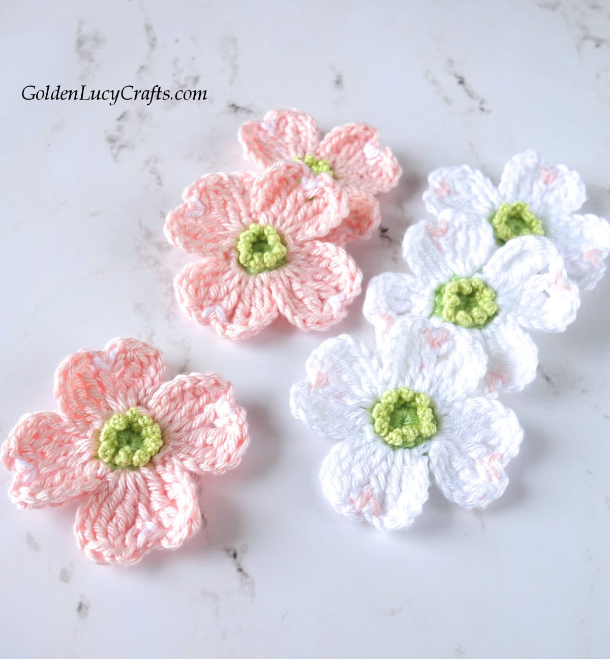 Crochet pink and white dogwood flowers.