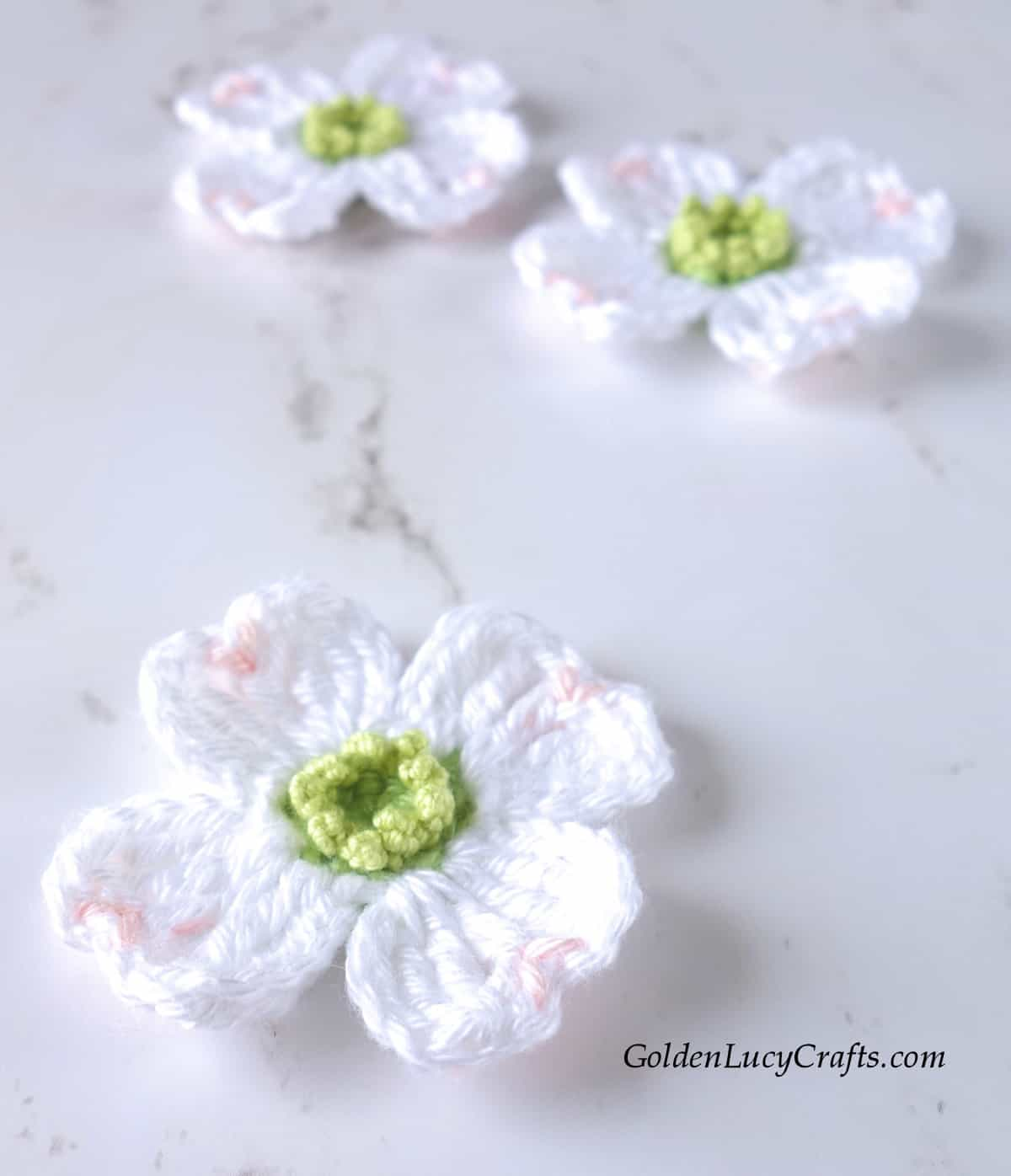White crochet dogwood flowers.