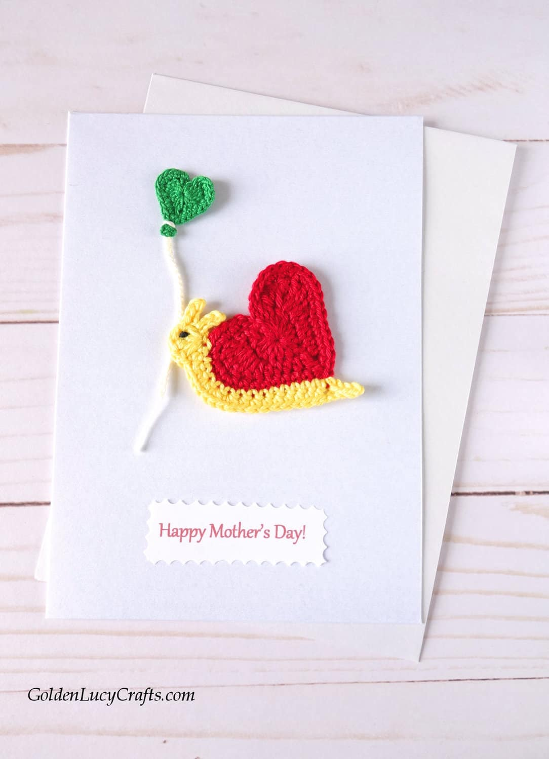 Mother's Day handmade card with crocheted heart snail applique.