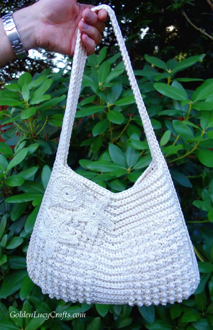 Crochet handbag embellished with ocean-themed appliques