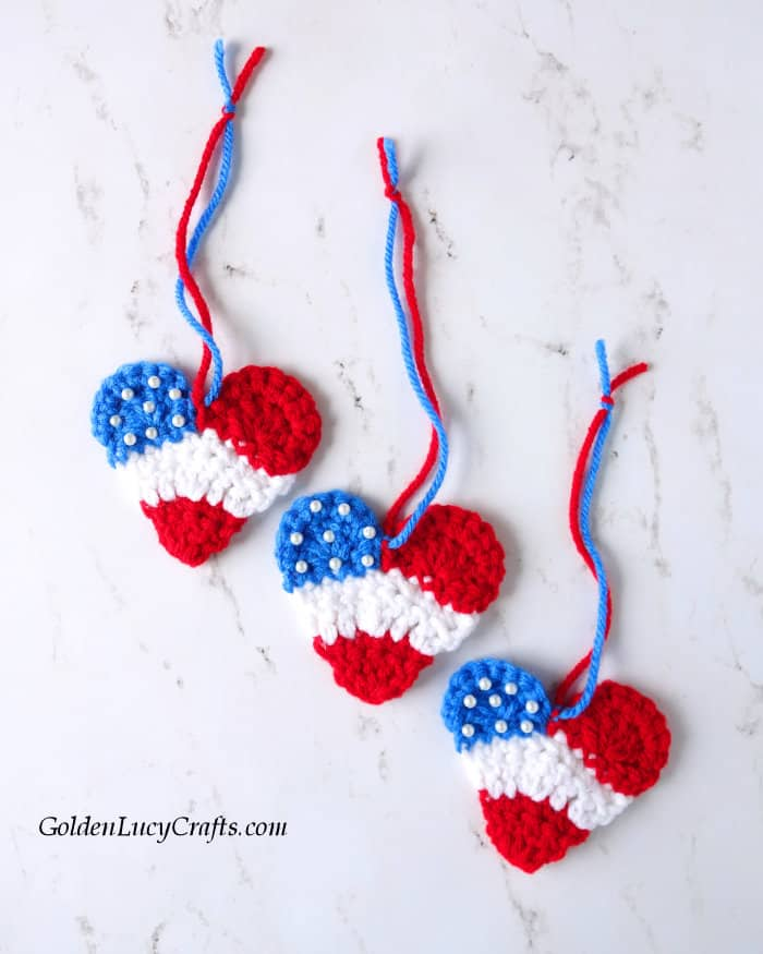 Three heart ornaments in red, white and blue colors.