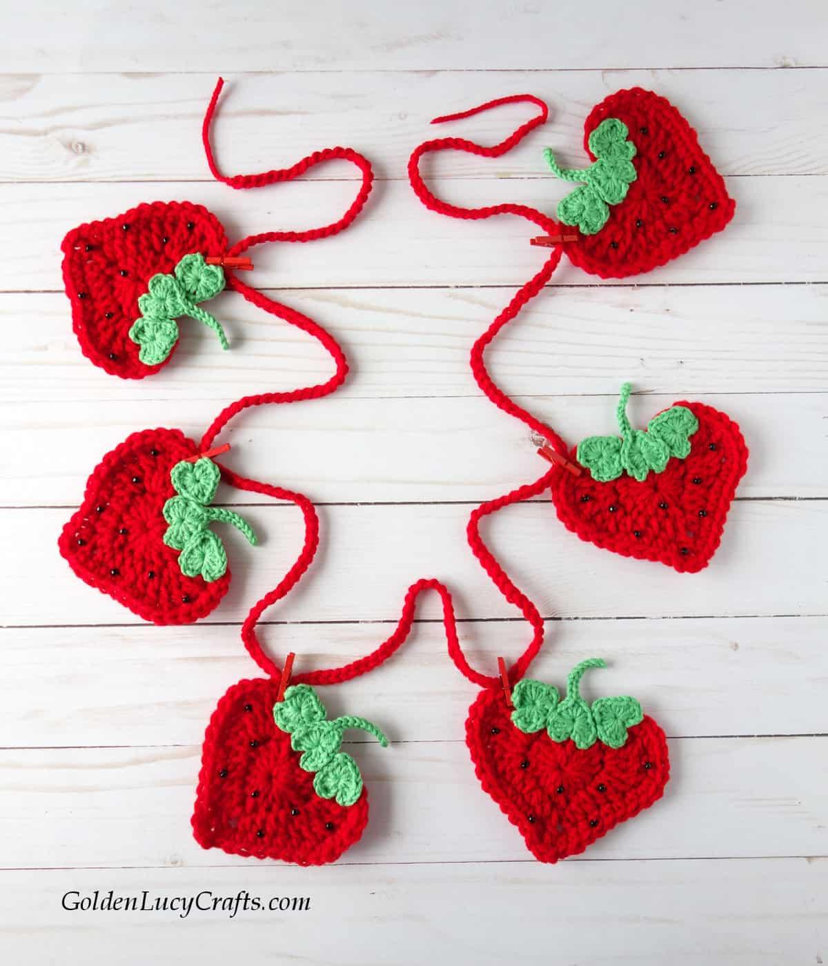 Crochet strawberry garland.