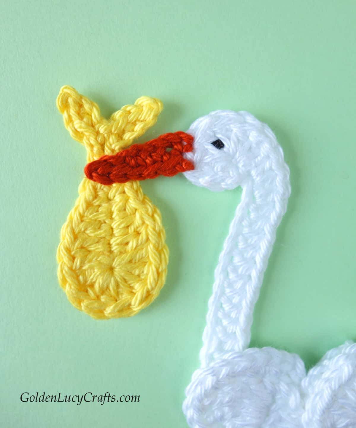 Head of Stork applique, baby bundle in his beak.