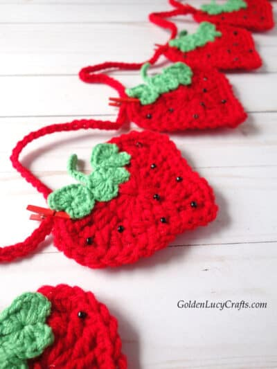 Crochet strawberry garland close up picture.