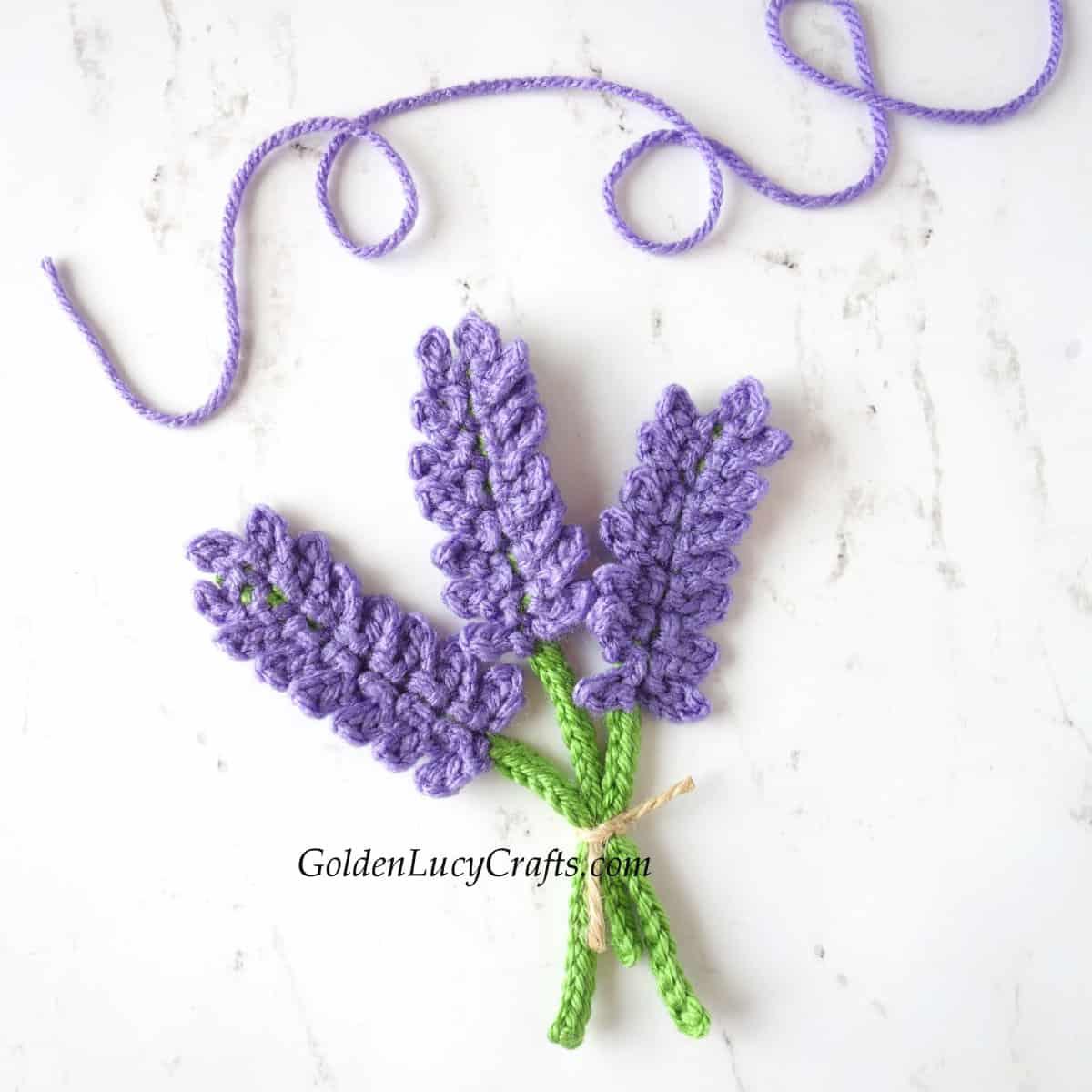 Crocheted lavender applique.