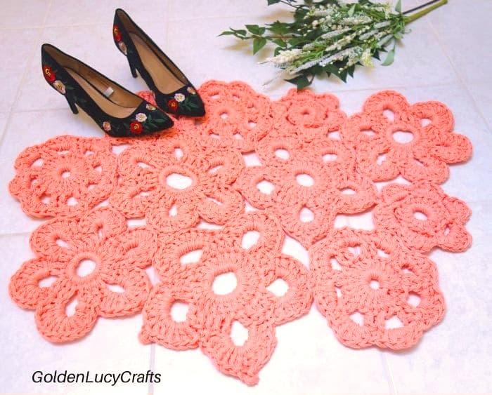 Crochet coral pink flower rug
