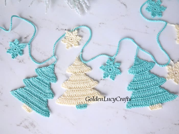 Christmas tree garland in turquois and cream colors