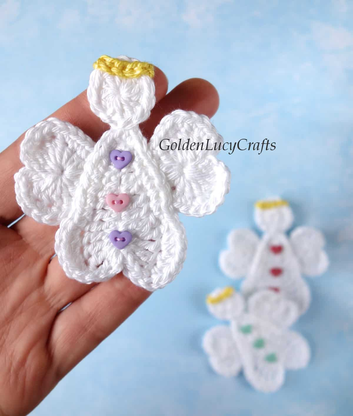Crochet heart angel applique in the palm of a hand