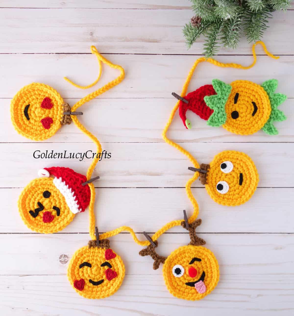 Crochet Christmas emoji garland.
