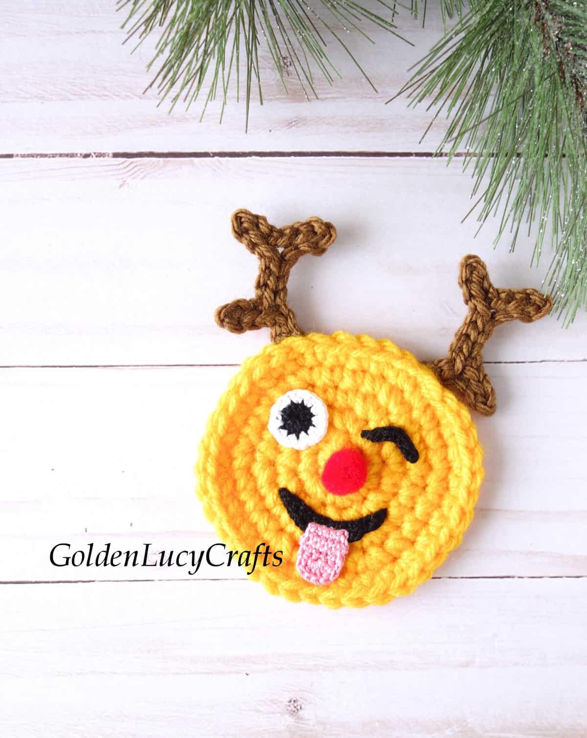 Crochet reindeer emoji applique.