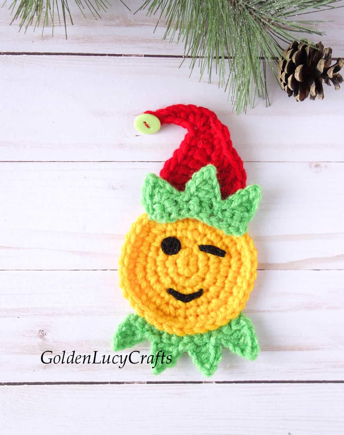 Crochet elf emoji applique.