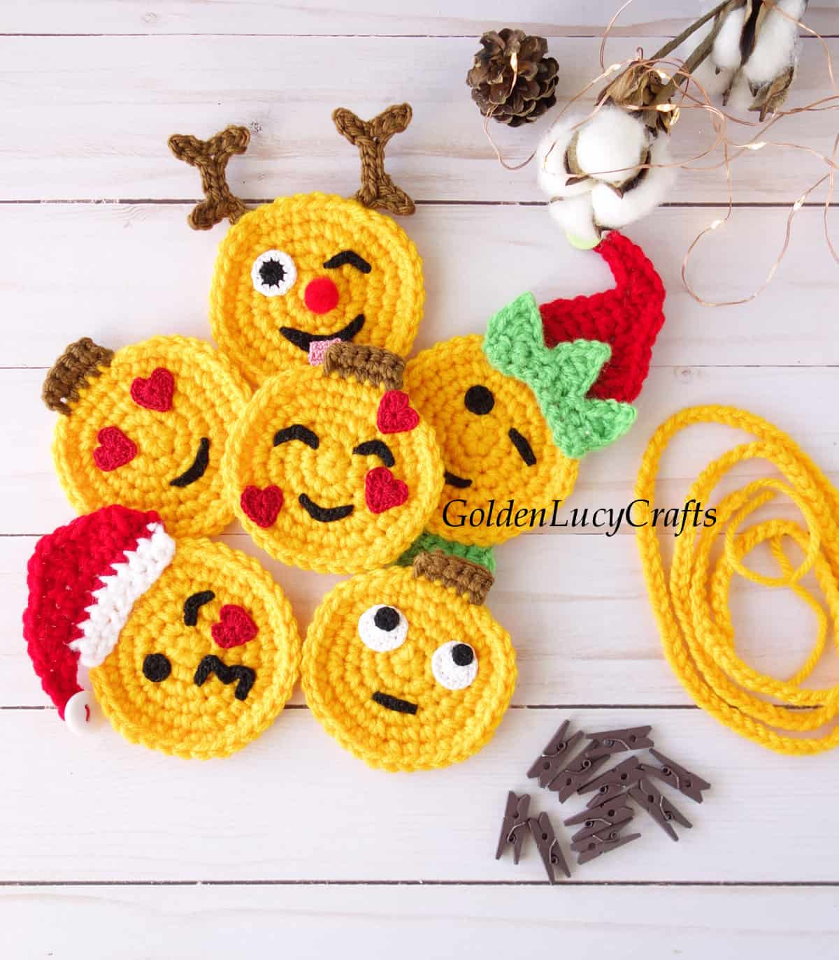 Crocheted emoji appliques, craft clothespins, crocheted string.