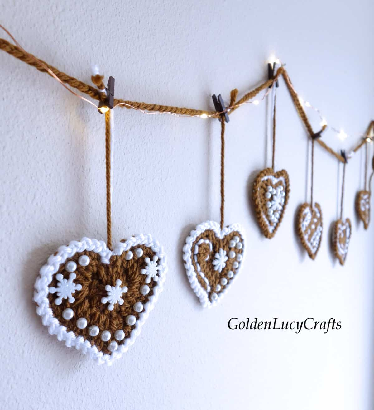 Crochet gingerbread garland hanging on the wall