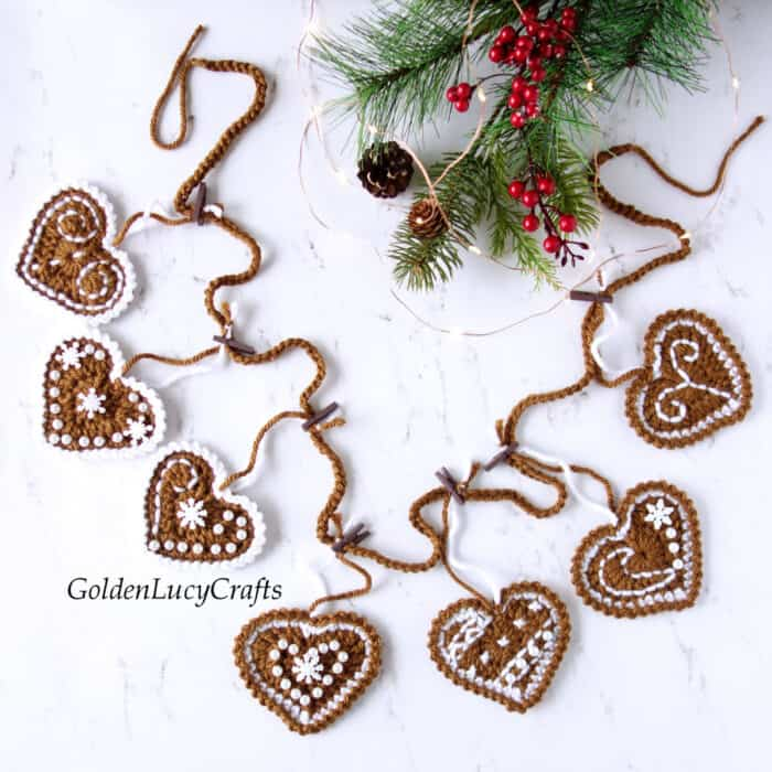 Crocheted gingerbread garland laying on the flat surface