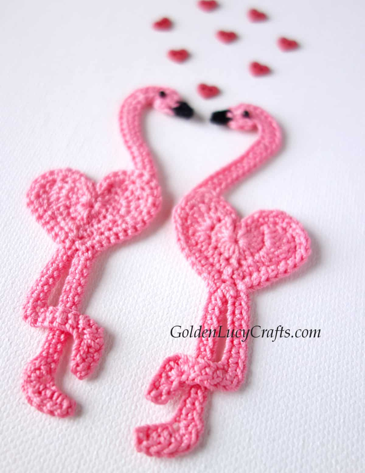 Two pink flamingo appliques close up image.