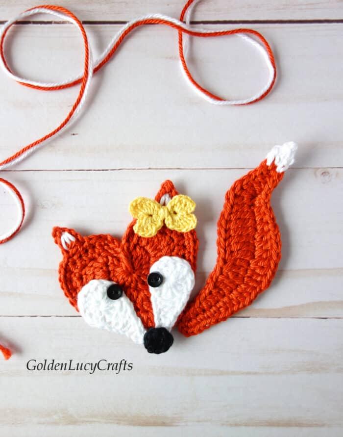 Crochet heart-shaped fox applique.