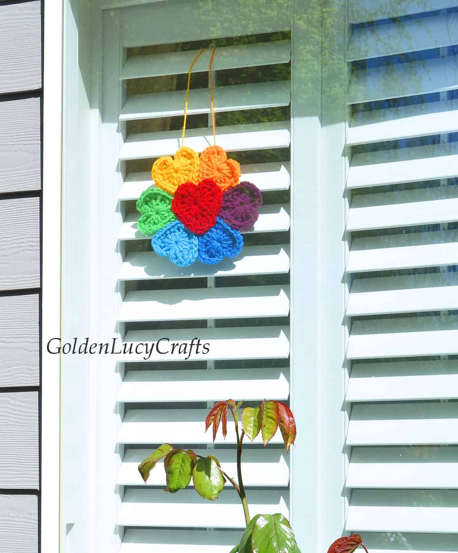 Crochet rainbow flower for window.