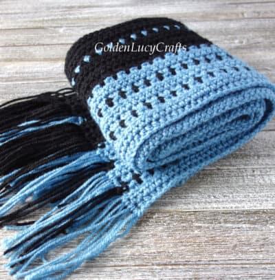 Rolled crochet men's scarf.