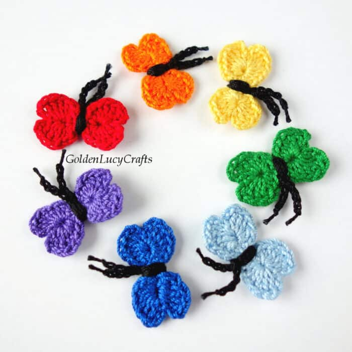 Crochet small butterflies in rainbow colors.