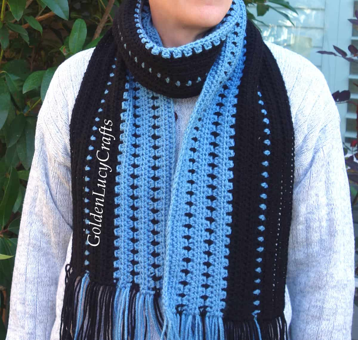 Man dressed in handmade scarf.