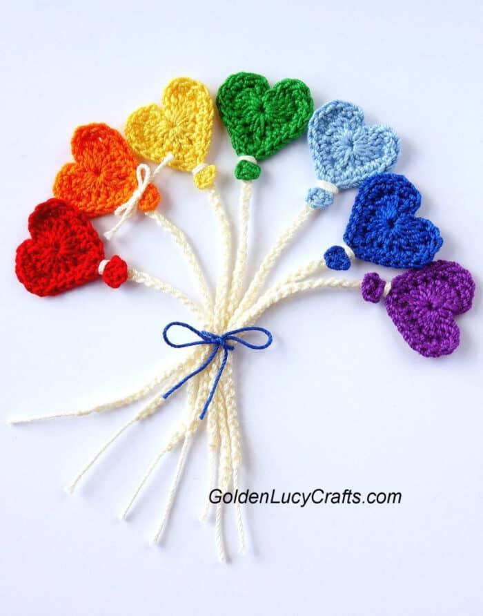 Bunch of crochet heart-shaped balloon appliques.