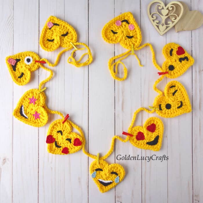 Crochet garland made from heart-shaped emojis.