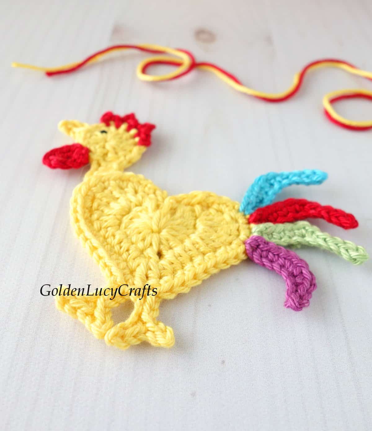 Crocheted rooster applique close up image.