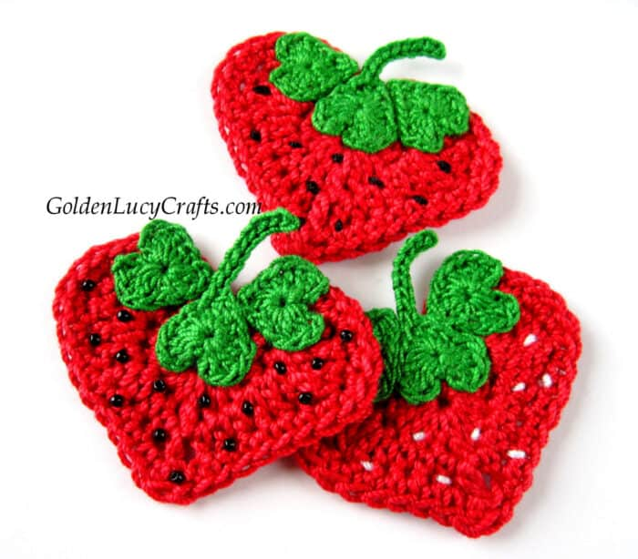 Crochet heart-shaped strawberry appliques.