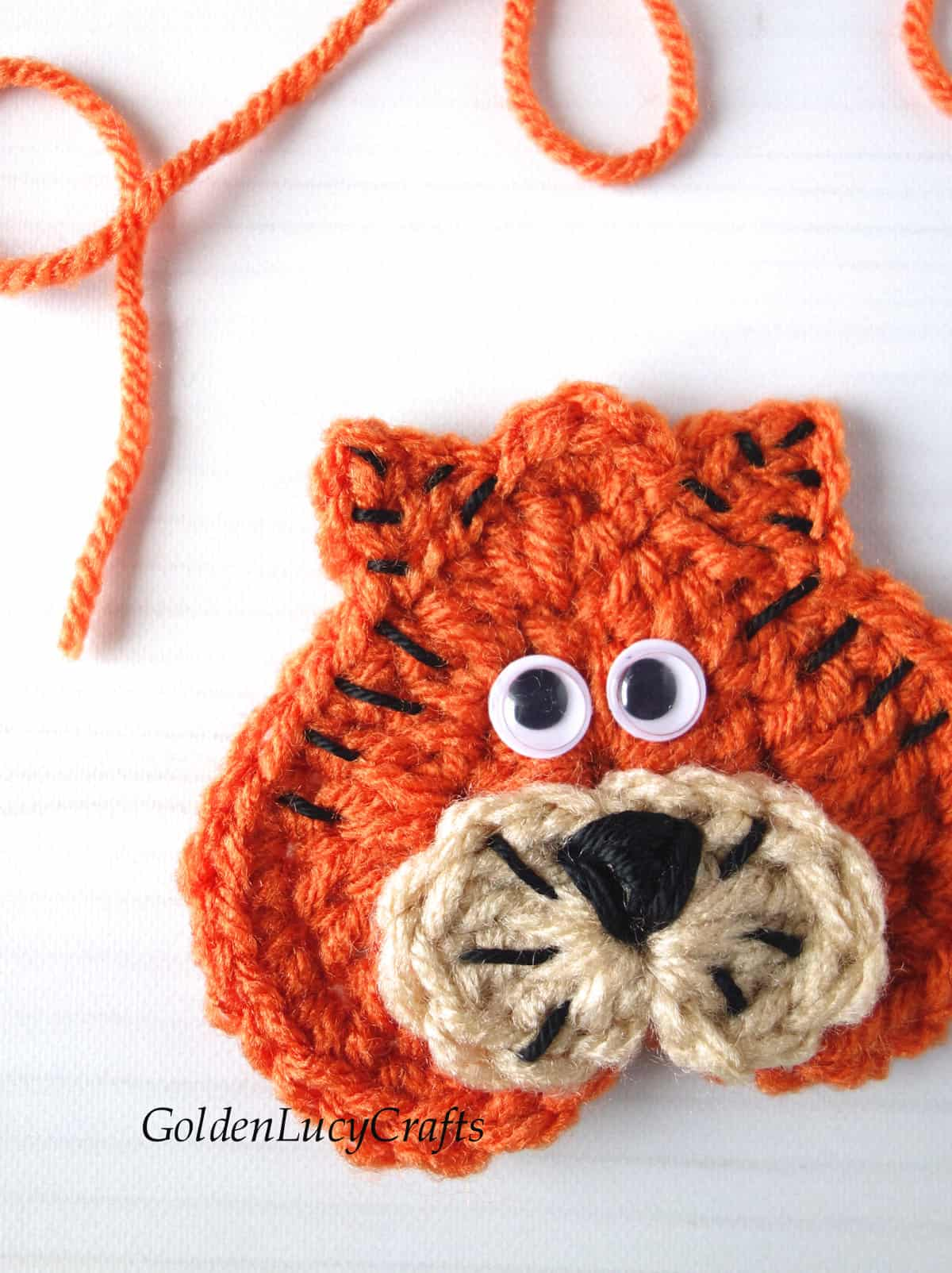 Crocheted Tiger applique close up image.