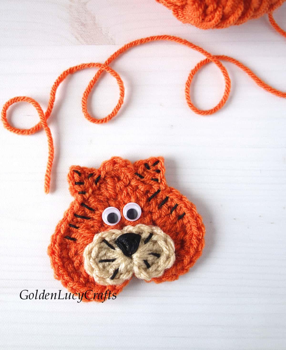 Crochet heart-shaped tiger applique.