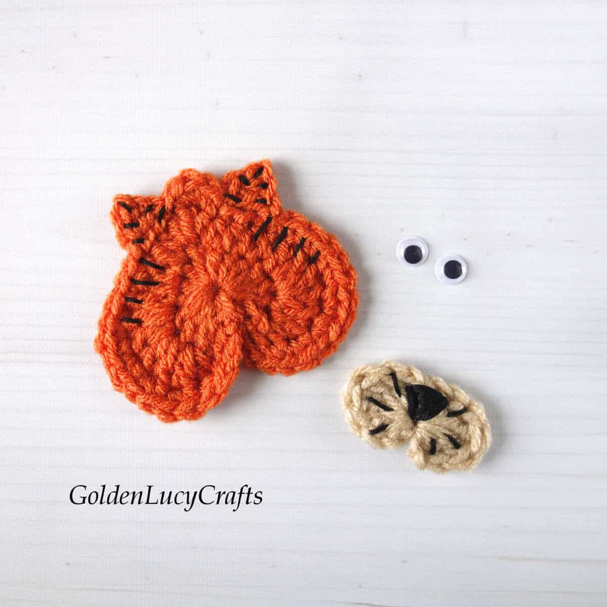 Parts of crocheted tiger applique - a head and a snout.