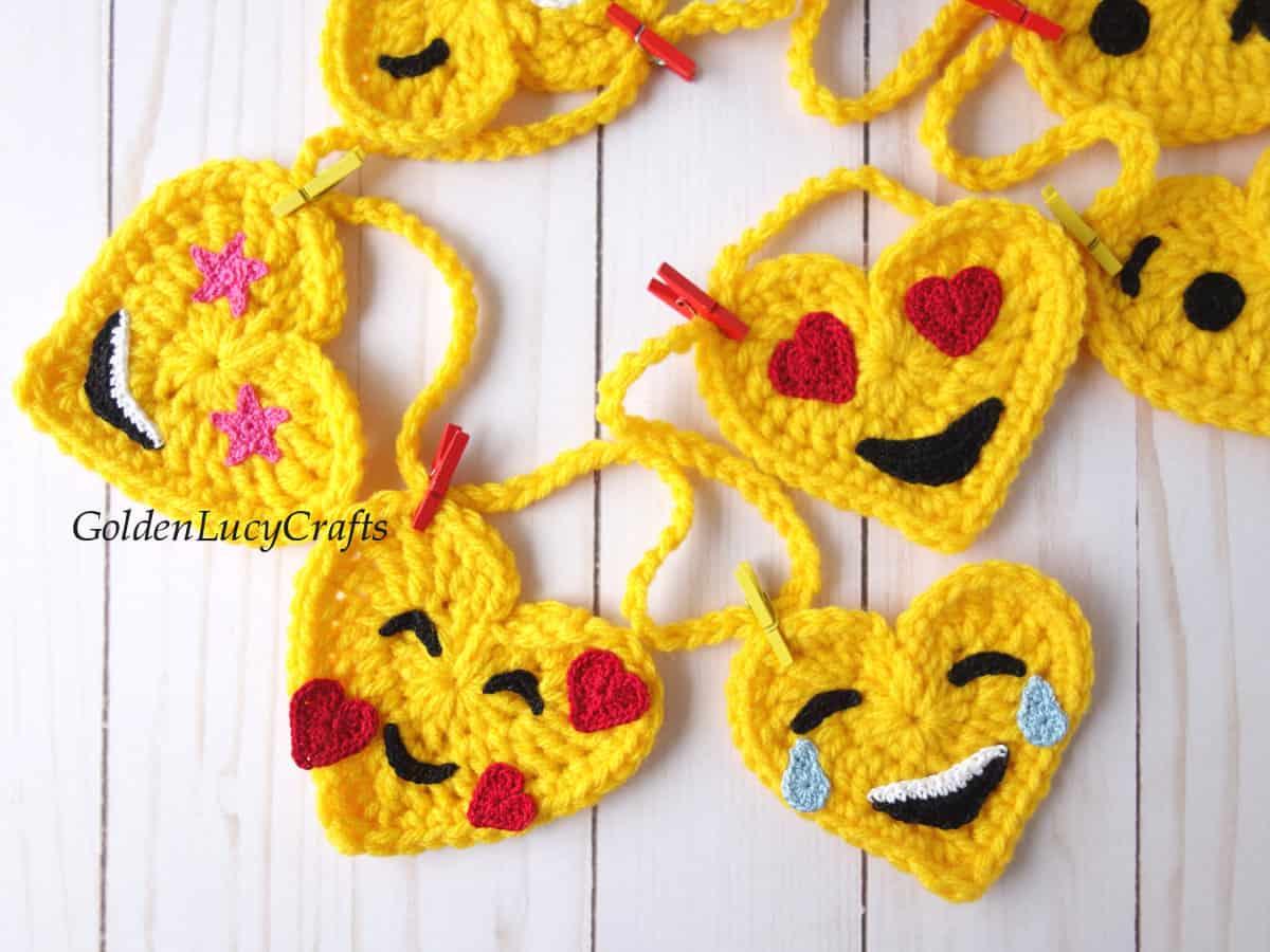 Crochet heart emoji garland, close up picture.