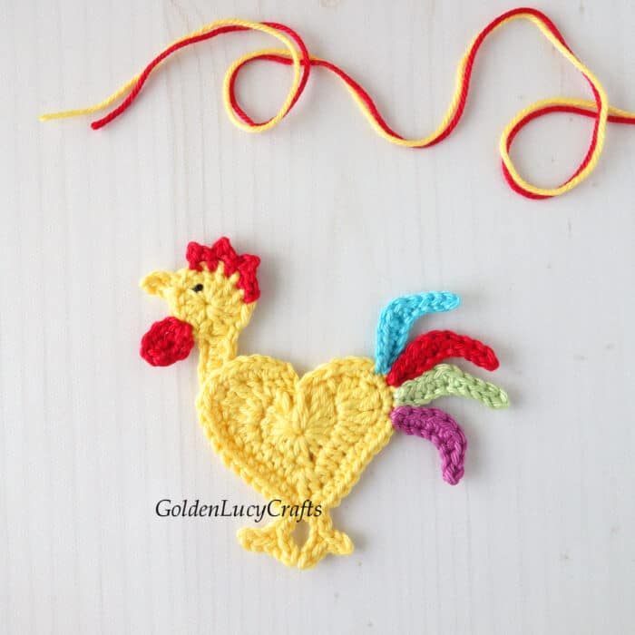 Crocheted colorful rooster applique.
