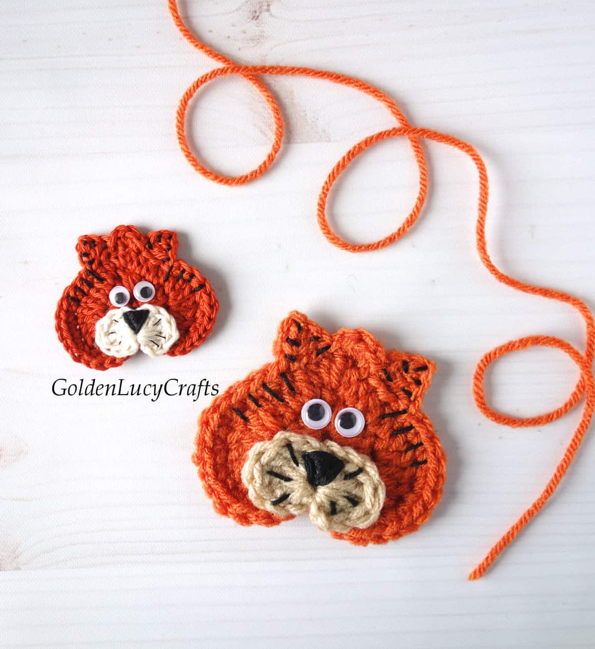 Two crocheted Tiger applique made in different sizes.