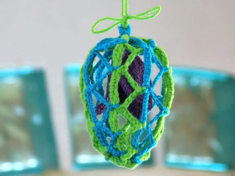 Crocheted lacy Easter egg with flower inside.