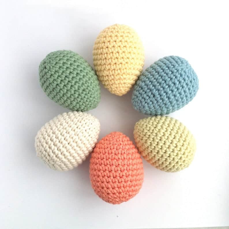 Six crocheted eggs laying in the round.