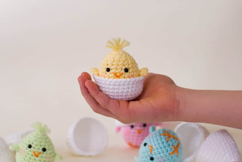 Crocheted hatched chick in hand.
