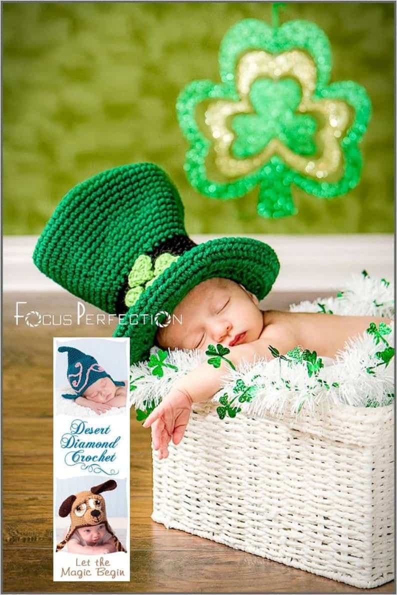 Baby in green hat is sleeping in the basket.