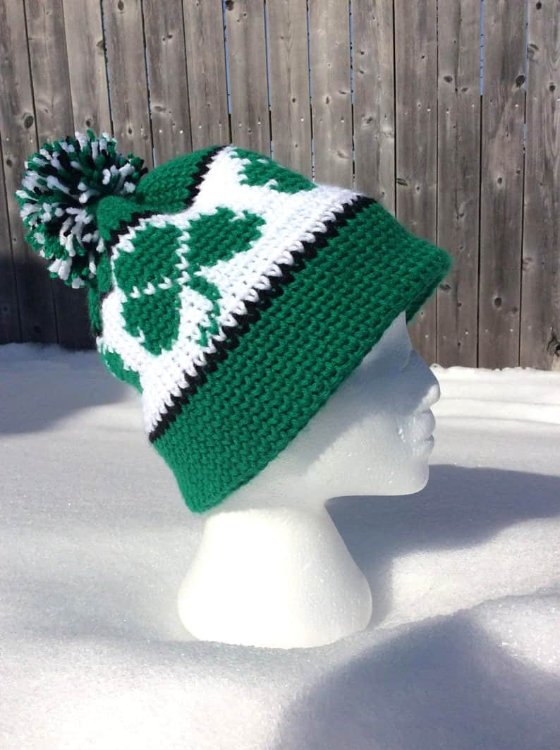Crocheted hat with shamrocks for St. Patrick's Day.