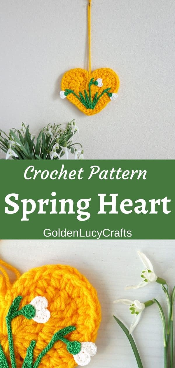Crocheted yellow heart with crocheted snowdrops on it wall decor, real snowdrops in a vase on the top, close up image of heart with snowdrops on the bottom.