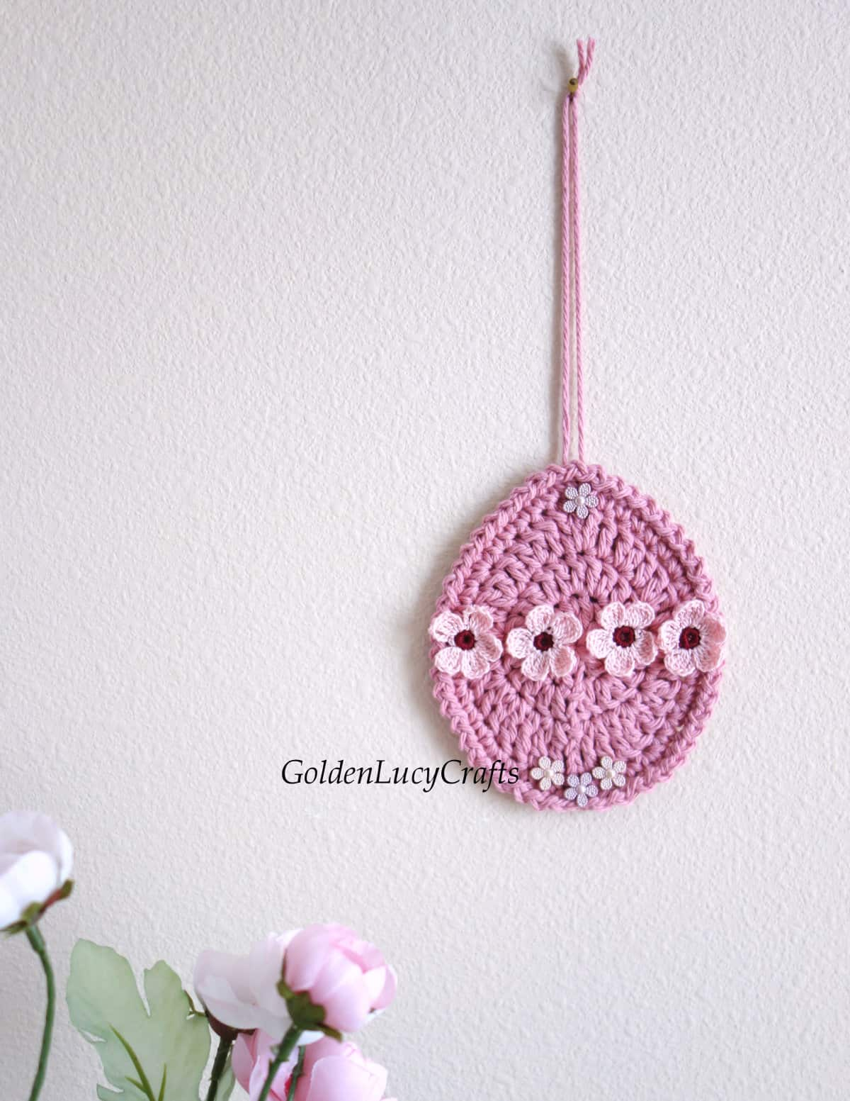 Crocheted Easter egg wall decoration.